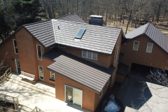 Rustic and Standing Seam Metal Roofing in Mustang Brown