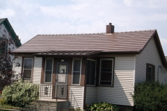 Oxford and Standing Seam Metal Roofing in Caramel