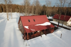 Rustic and Standing Seam Metal Roofing in Terra Red