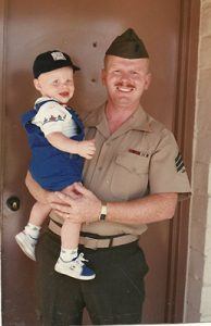Ray in uniform holding child